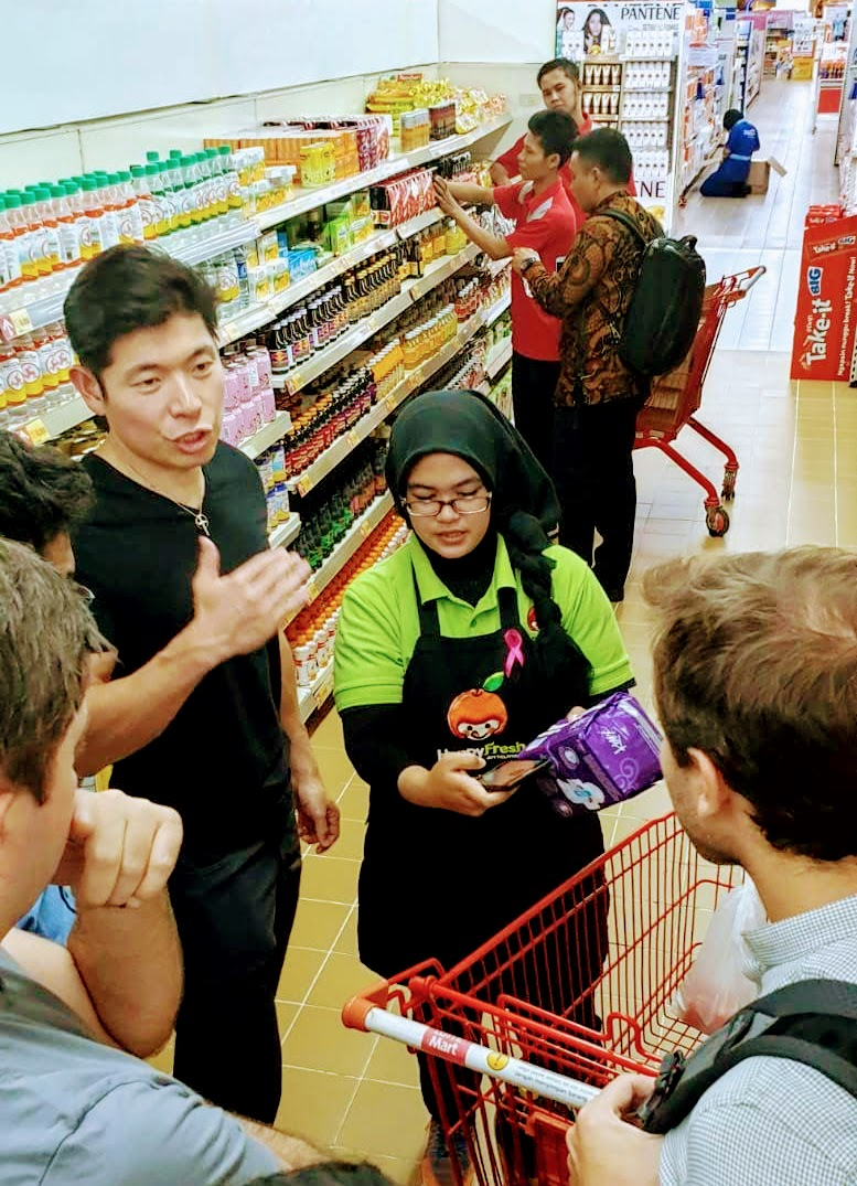 Our CEO, Anthony Tan, picking items for a customer, on an immersion trip.